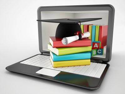 computer with books and diploma