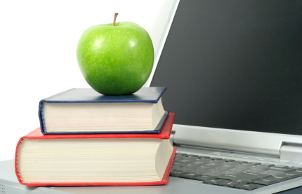 laptop with books and apple