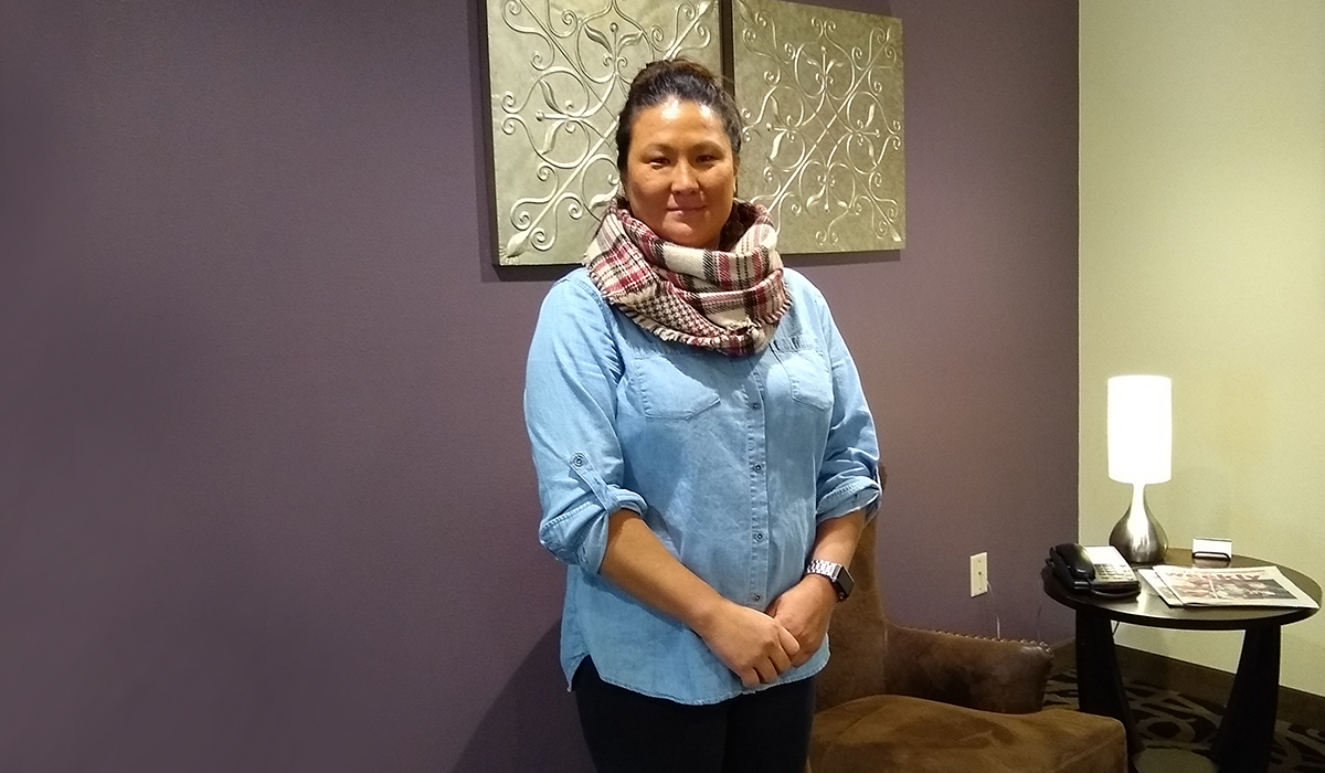 General Manager Shaleena Bott poses for a photo in the hotel lobby.